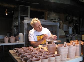 Joe Pinder glazing pottery